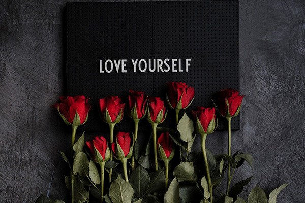 Love yourself message with flowers