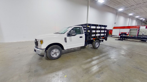 8-Stakebed-Ford-F-350-smyrna-truck-dr side.jpg