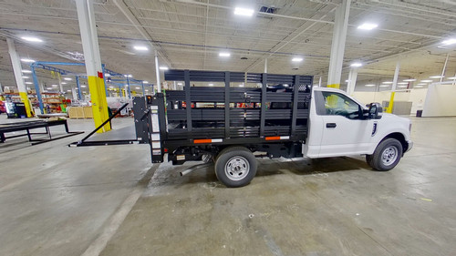 8-Stakebed-Ford-F-350-smyrna-truck-sidewithliftgate.jpg